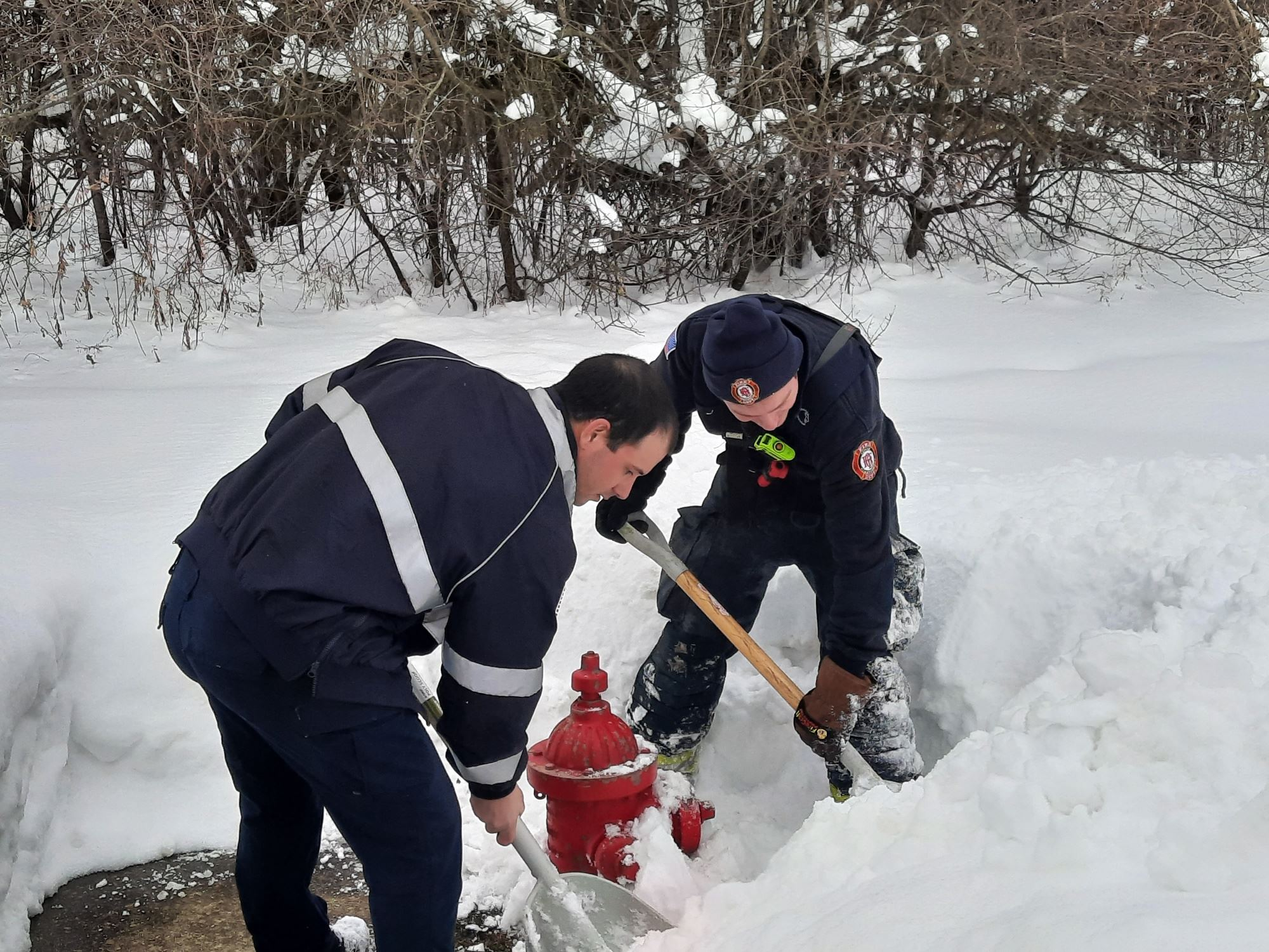 Firefighters Removing Snow